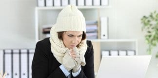 Cold executive working with a heater failure in winter